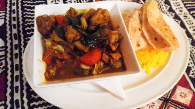 Our famous Jungle curry with roti bread and yellow rice