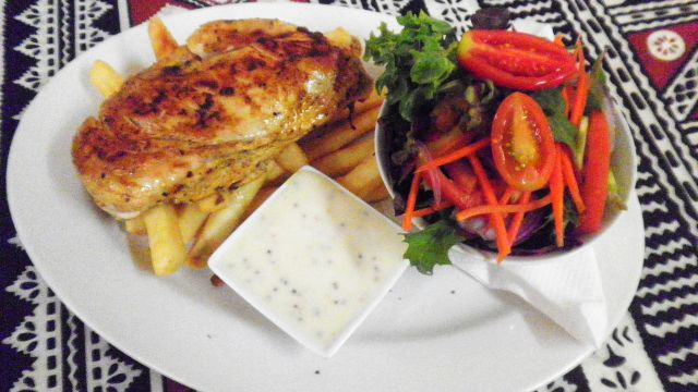 Grilled chicken breast with seeded mustard, chips and salad